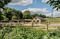 3 bed barn, 9 stables, sandschool & 9 ac...